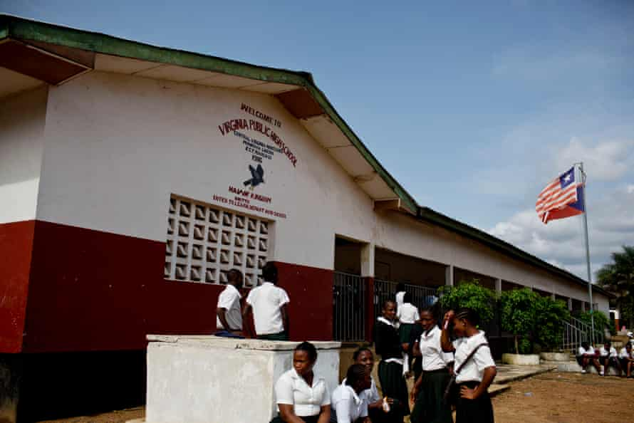 Girls wait for their lessons outside a classroom at the Virginia secondary school in Montserrado