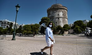 A woman wears a protective mask in Thessaloniki, Greece.
