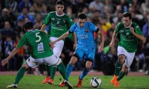Munir el Haddadi of Barcelona gets past Javi Sanchez of Villanovense during of the Copa del Rey match.