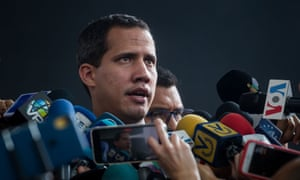 Juan Guaidó speaks with journalists before the start of a parliamentary session in an auditorium located in the El Hatillo sector, in eastern Caracas.