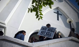 People arrive for Sunday services at the Emanuel African Methodist Episcopal (AME) Church in Charleston, South Carolina, after the shooting last year.