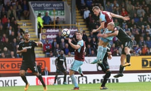 Chris Wood leaps to score Burnley's late equaliser against West Ham, who played most of the game with ten men following the dismissal of Andy Carroll.