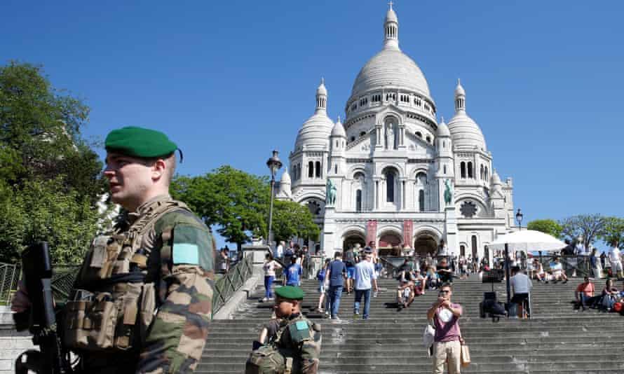 Soldiers on patrol at Sacre Coeur church in Montmartre, Paris.