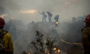 Firefighters Battle The Dolan Fire On California's Big Sur Coastline<br>Firefighters light a controlled burn while fighting the Dolan Fire near Big Sur, California, U.S., on Sunday, Sept. 13, 2020. The wildfire burning in the rugged mountains of California's Big Sur coastline has burned more than 117, 242 acres near Big Sur and is 40% contained, according to the U.S. Forest Service. Photographer: Nic Coury/Bloomberg via Getty Images