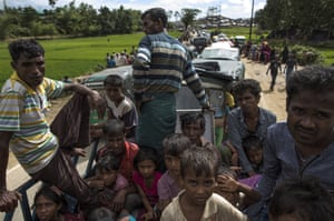 Rohingya refugees are transported to a camp in the back of a lorry after arriving in Kutupalong from Myanmar
