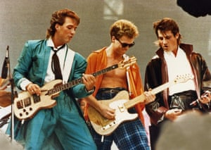 Martin Kemp, Gary Kemp and Tony Hadley on stage at Live Aid. Hadley remained dedicated to the band's look and despite the heat (and sweat) wore a leather trench coat, also lined with leather, for the 15 minute set.