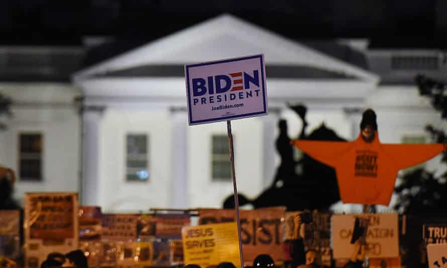 Demonstrators gather across from the White House on election day in Washington, DC.