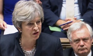 David Davis listens as Theresa May addresses parliament in a Brexit speech in October 2017.