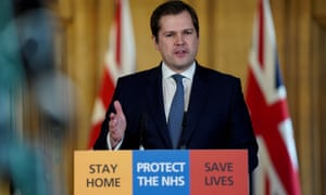Robert Jenrick answering questions during a media briefing in Downing Street last month.