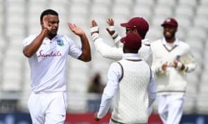 Shannon Gabriel celebrates taking the wicket of Jos Buttler.