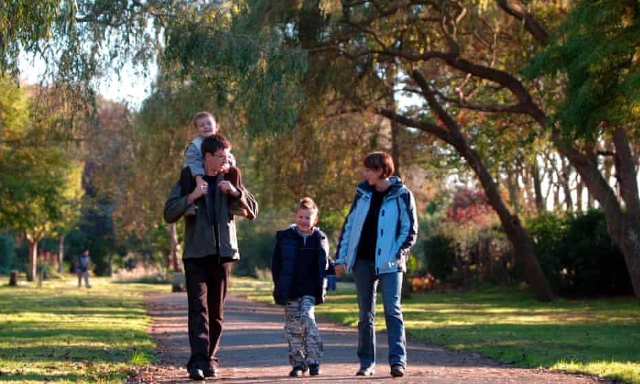 White family walks in park