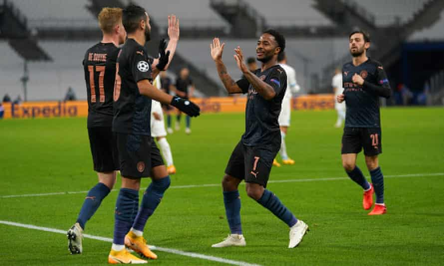 Raheem Sterling celebrates after he scored Manchester City's third goal against Marseille.
