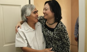 Kim Phuc, right, hugs Nick Ut during a reunion in 2012.
