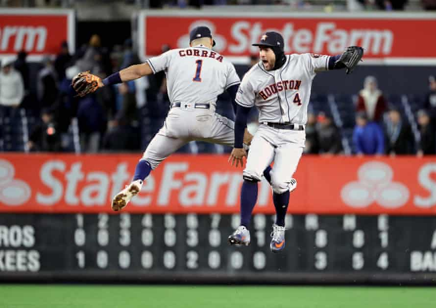 Carlos Correa and George Springer celebrate a victory over the Yankees in Game 4 of the ALCS