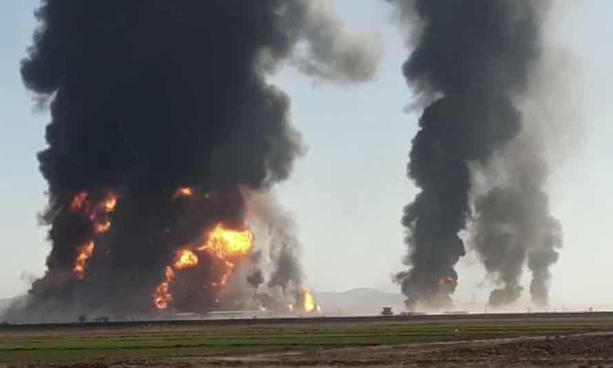 Fire and smoke rise from an explosion of a gas tanker in Herat, Afghanistan