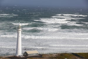 Cape Town, South Africa: Strong waves roll towards Slangkop lighthouse during a storm with gale force winds which lashed the peninsula