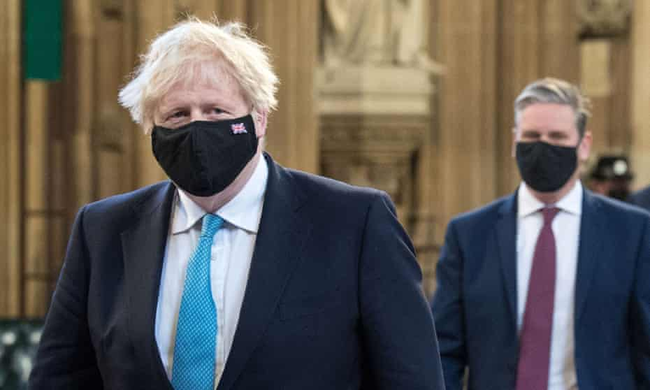 Boris Johnson, left, and Keir Starmer at the state opening of parliament in May