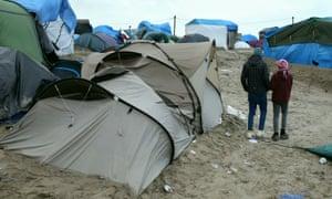 Orphaned refugee children walk through the refugee camp at Calais.