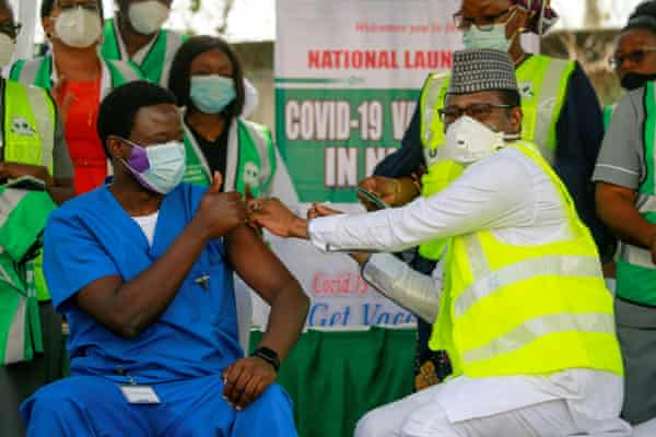A health official receives his first dose of a Covid vaccine at a hospital in Abuja, Nigeria.