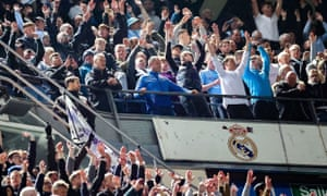 Manchester City fans celebrate a famous win at the Bernabéu at full time.