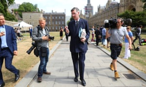 Brexit campaigner Jacob Rees-Mogg talks to reporters outside the Houses of Parliament