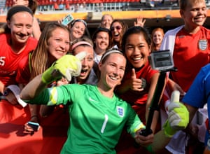 England goalkeeper Karen Bardsley joins in the selfie craze as she celebrates with fans after winning against Norway.