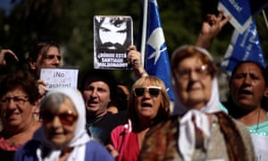 A man holds up a portrait of Santiago Maldonado during a demonstration in Buenos Aires on Thursday.