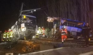 The wreckage of the bus at the scene.