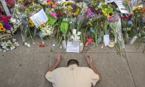Raymond Smith of Charleston kneels in prayer at the front of the Emanuel AME church on Sunday, before the first service since nine people were fatally shot at the church