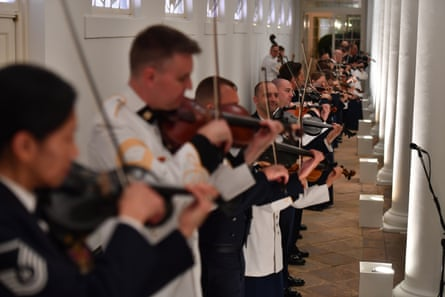 Violinists practice during a preview of the tables and settings for the state dinner in the Rose Garden at the White House.