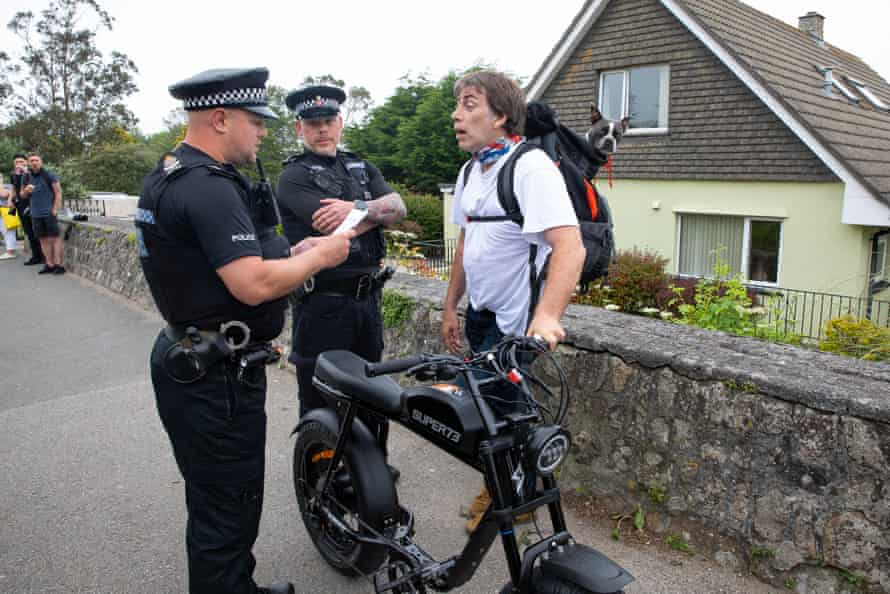 A man remonstrates with police over restrictions in Carbis Bay.