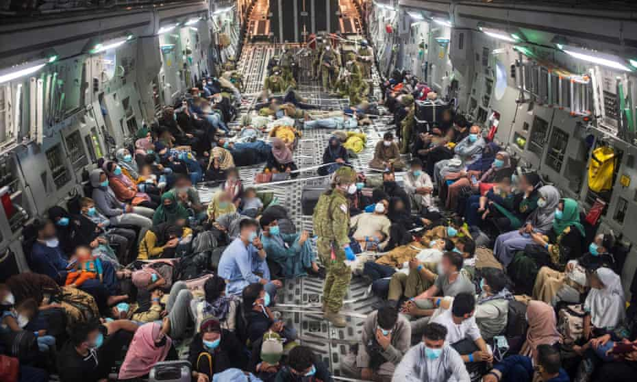 Australian citizens and visaholders onboard a Royal Australian Air Force aircraft after evacuating from Afghanistan.
