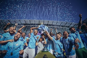 6 May 2018: Kompany lifts the Premier League trophy after drawing 0-0 with Huddersfield at the Etihad Stadium.