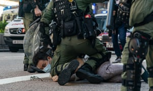 A man is arrested during an anti-government protest in Hong Kong. Freedom swimmer Wong Hung said he could identify with the protesters.