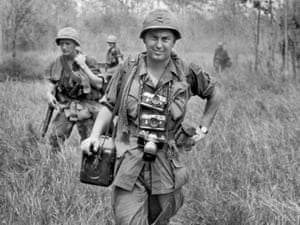 AP photographer Horst Faas, with his Leica cameras around his neck, accompanies US troops in War Zone C