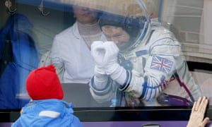 Peake says goodbye to his children from a bus before boarding the Soyuz rocket.