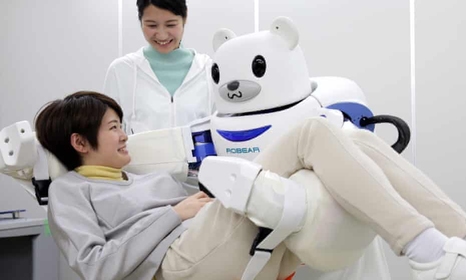 """A robot """"Robear"""" lifting a woman for a demonstration in Nagoya, central Japan. The robot can transfer frail patients from a wheelchair to a bed or a bath."""