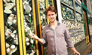 Craig Reucassel with a tram full of coffee cups in Melbourne.