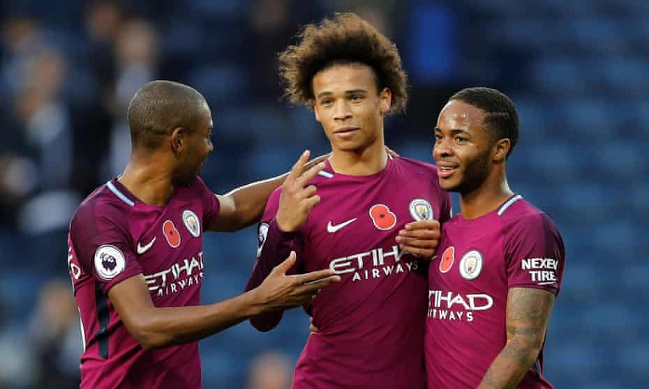 Manchester City's three scorers – Fernandinho, Leroy Sané and Raheem Sterling – celebrate after 3-2 win at West Bromwich Albion