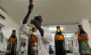 An employee at Southern Sudan Beverages checks on the quality of beer produced at the company's processing plant in Juba.