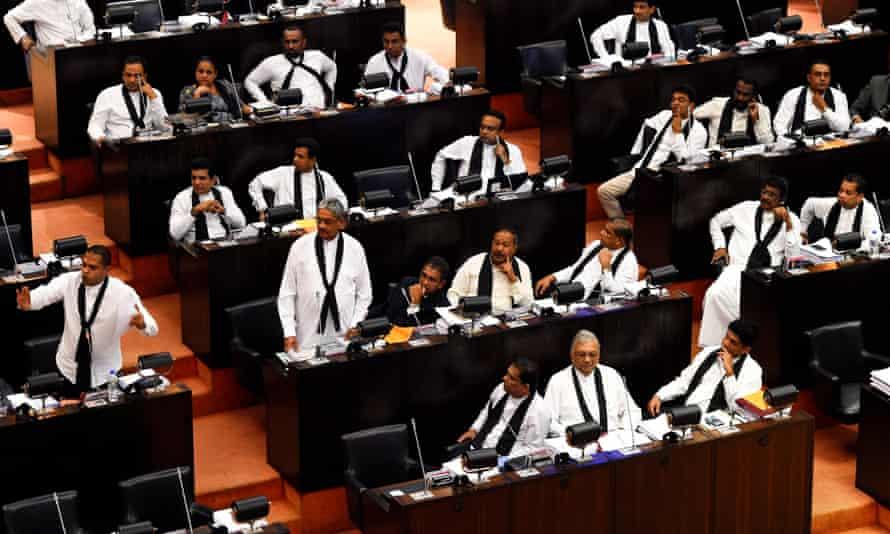 Opposition legislators wear black shawls in parliament