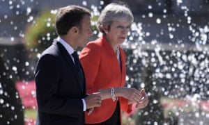 Macron, left, presented himself as a champion of EU unity as May suffered