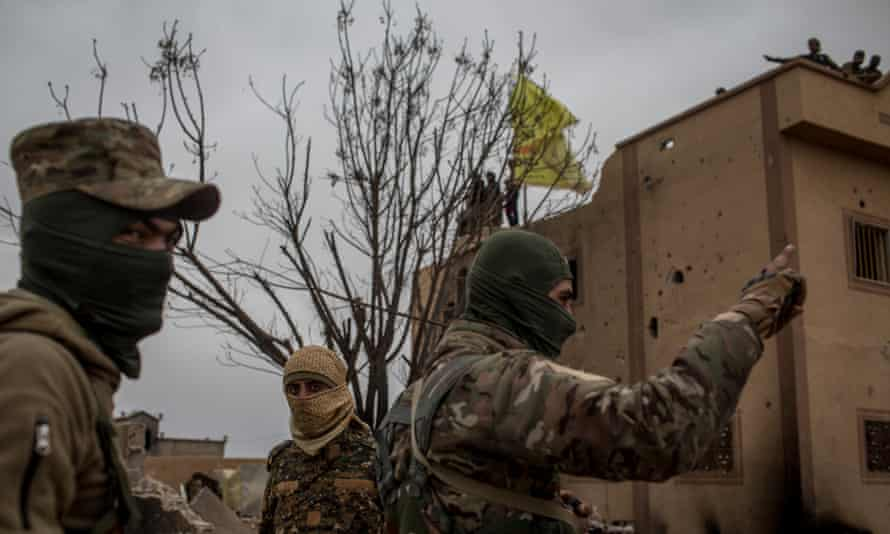 Syrian Democratic Forces fighters in Baghouz, Syria