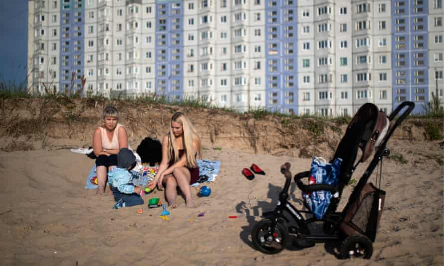 Women with a child on the beach by the Severnaya Dvina River in Severodvinsk, Russia