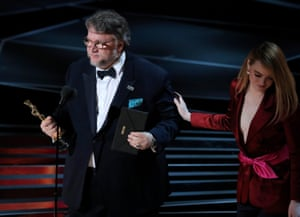 Guillermo del Toro accepts the Oscar for best director for The Shape of Water from presenter Emma Stone
