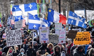 People take part in a demonstration to oppose government restrictions to curb the spread of Covid-19 in Montreal on Saturday.