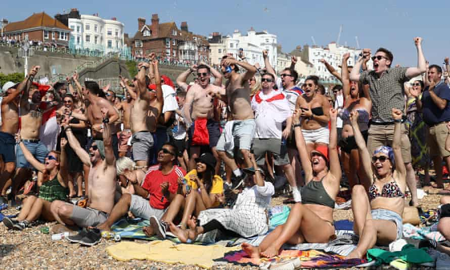 Football fans watch England take on Sweden in the World Cup quarter-final
