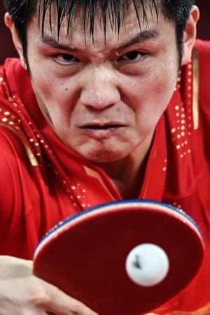 China's Fan Zhendong competes against South Korea's Jang Woo-jin during their men's team semi-final table tennis match.