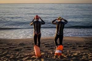 Barcelona, Spain. Swimmers get ready to enter the sea at La Barceloneta beach as part of the gradual easing of the coronavirus lockdown restrictions