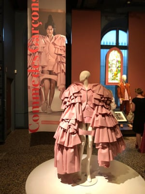 A Comme Des Garçons outfit brought to life by Moore's photography.